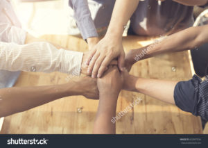 stock-photo-people-putting-their-hands-together-for-united-cooperation-a...